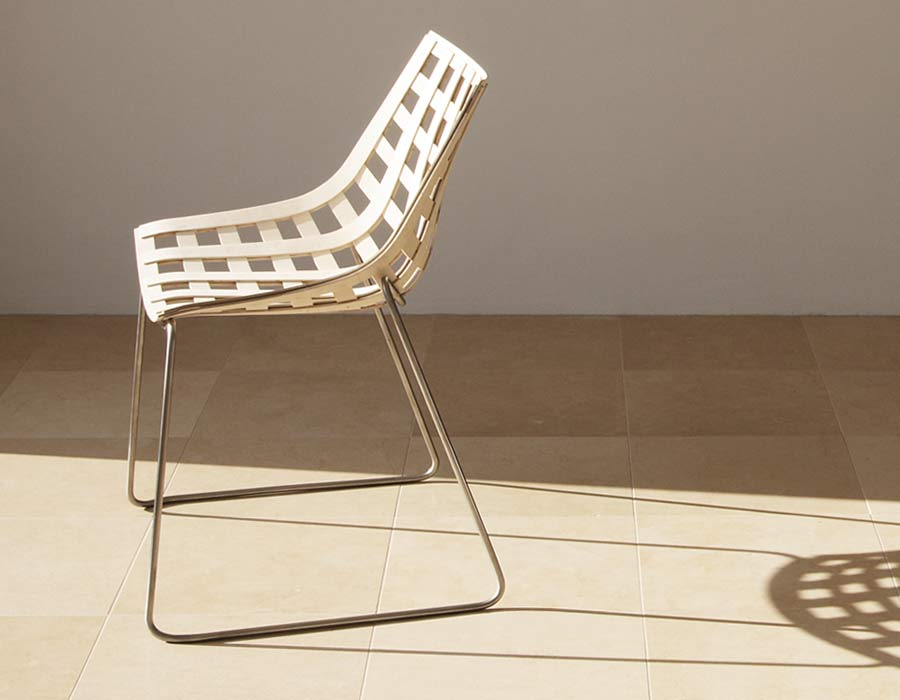 Plywood Chair Global in the sunshine